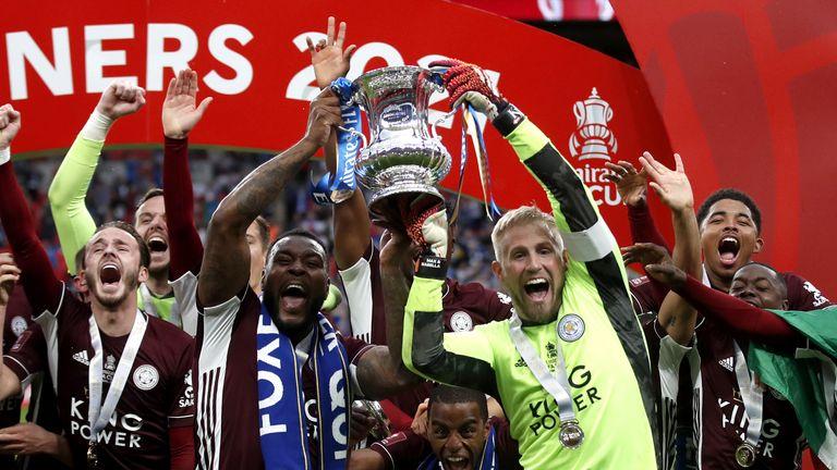 PA - Wes Morgan and Kasper Schmeichel lift the FA Cup at Wembley