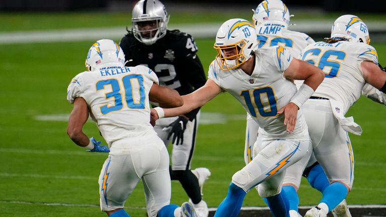 Los Angeles Chargers running back Austin Ekeler describes Justin Herbert's progress from last season to this as like night and day
