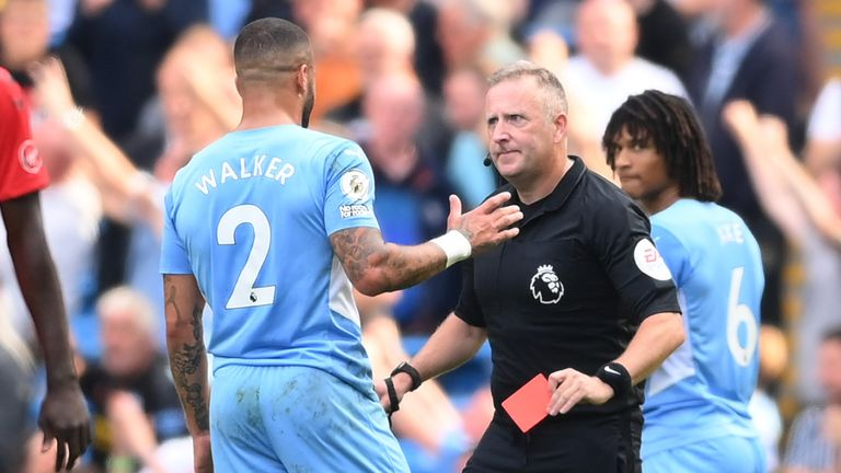 Referee Jonathan Moss shows Kyle Walker a red card which he later overturns following a VAR review