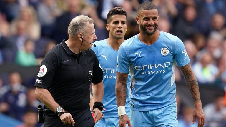 Kyle Walker smiles after his reprieve from referee Jonathan Moss