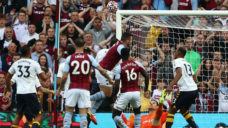 Asmir Begovic makes a save from a Tyrone Mings header