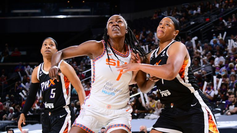 Beatrice Mompremier #1 of the Connecticut Sun and Kia Vaughn #1 of the Phoenix Mercury fight for position during the game on September 11, 2021 at Footprint Center in Phoenix, Arizona.