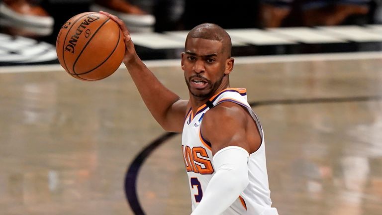 Phoenix Suns guard Chris Paul (3) looks to pass during the first quarter of an NBA basketball game against the Brooklyn Nets, Sunday, April 25, 2021, in New York.